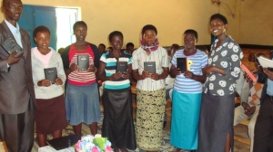 Group members receive Bibles in Gahanga